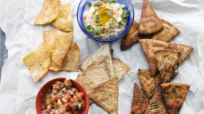 In this image taken on June 10, 2013, from left, fried tortilla chips with cinnamon sugar, baked whole wheat tortilla chips, and baked whole wheat pita chips are shown in Concord, N.H. (AP Photo/Matthew Mead)