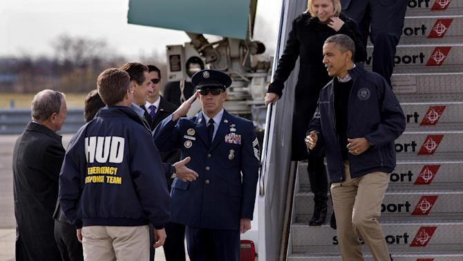 President Barack Obama, followed by Sen. Kirsten Gillibrand, D-N.Y. and Sen. Charles Schumer, D-N.Y., is greeted by, from left, New York City Mayor Michael Bloomberg, Housing and Urban Development Secretary Shaun Donovan, back to camera, and New York Gov. Andrew Cuomo, upon their arrival at JFK International Airport in New York, Thursday, Nov. 15, 2012, before taking a aerial tour of damage along the New York coastline in the of Superstorm Sandy. (AP Photo/Craig Ruttle)