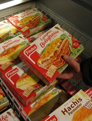 "A customer holds a pack of Findus Beef Lasagne Bolognaise in a freezer of a supermarket in Nice, southeastern France, Monday, Feb. 11, 2013. Complex trading between wholesalers has made it increasingly difficult to trace the origins or destination of food like the horsemeat disguised as beef being sold in frozen meals across Europe's open borders, and France's agricultural minister said it was up to regulators to find a way ""out of the fog."" (AP Photo/Lionel Cironneau)"
