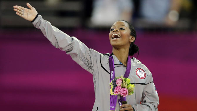 FILE - In this Aug. 2, 2012, file photo, Gabrielle Douglas, of the United States, acknowledges the crowd after receiving her gold medal in the artistic gymnastics women's individual all-around competition at the 2012 Summer Olympics in London. Douglas, who became the first African-American gymnast to claim gymnastics' biggest prize _ the all-around Olympic title _ is The Associated Press' 2012 female athlete of the year. (AP Photo/Gregory Bull, File)