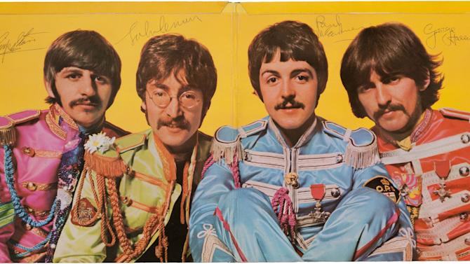 "This undated image provided by Heritage Auctions shows what is described as a ""pristine"" copy of The Beatles' ""Sgt. Pepper's Lonely Hearts Club Band"" album autographed by all four members of the band, that is up for auction. A statement from Dallas-based Heritage Auctions says the bidding for the album has passed $110,000 and could surpass $150,000 by the time bidding is closed on March 30. (AP Photo/Heritage Auctions)"