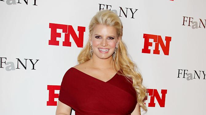 FILE - In this Nov. 29, 2011 file photo, singer Jessica Simpson poses at the 25th Annual Footwear News Achievement Awards at The Museum of Modern Art in New York.  (AP Photo/Starpix, Amanda Schwab)
