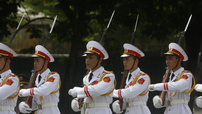 Military honour guard members march before a wreath-laying ceremony attended by Mukherjee at the War's Martyr monument in Hanoi