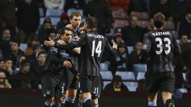 Manchester City's Carlos Tevez, left, runs to celebrate with his teammates after scoring against Aston Villa during their English Premier League soccer match at the Villa Park ground in Birmingham, England, Monday, March 4, 2013. (AP Photo/Lefteris Pitarakis)