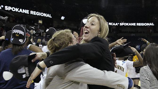 California head coach Lindsay Gottlieb is hugged after her team beat Georgia in overtime in a regional final in the NCAA women's college basketball tournament, Monday, April 1, 2013, in Spokane, Wash. Cal won 65-62. (AP Photo/Elaine Thompson)