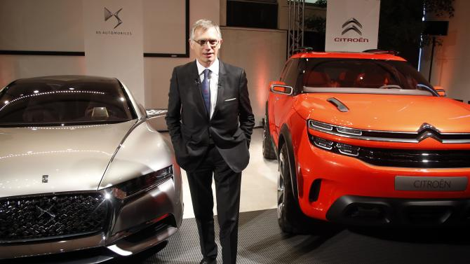 Carlos Tavares, CEO of French carmaker PSA Peugeot Citroen, poses before the company's 2015 First-Half results presentation at Peugeot headquarters in Paris