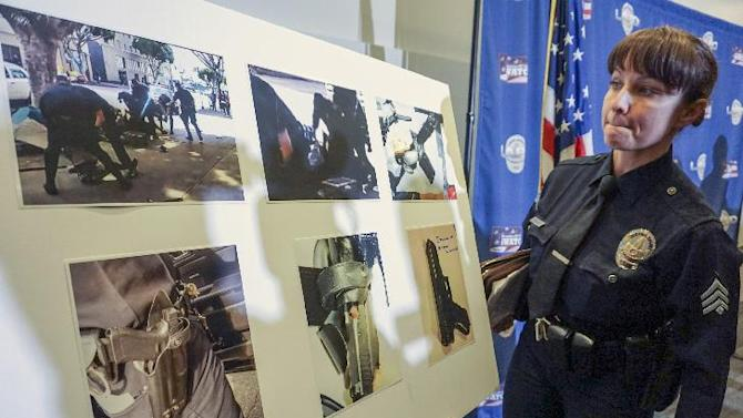 Los Angeles Police detective Meghan Aguilar explains images released by police that could indicate evidence of a suspect holding a police officer's gun, seen in a video shot by a witness at the scene of the shooting of a homeless man on Skid Row of Los Angeles, top row left, at a news conference at police headquarters Monday, March 2, 2015. Chief Charlie Beck says officers fatally shot a homeless man on Skid Row after he grabbed an officer's holster during a struggle. Three Los Angeles police officers shot and killed the man on Sunday, as they wrestled with him on the ground, a confrontation captured on video that millions have viewed online. Authorities say the man was shot after grabbing for an officer's gun. (AP Photo/Damian Dovarganes)