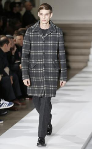 A model wears a creation of Jil Sander men's Fall-Winter 2013-14 collection, part of the Milan Fashion Week, unveiled in Milan, Italy, Saturday, Jan. 12, 2013. (AP Photo/Antonio Calanni)