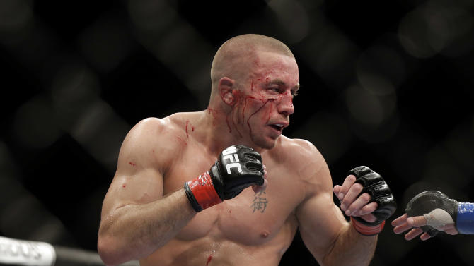 Georges St. Pierre retains title at UFC 167