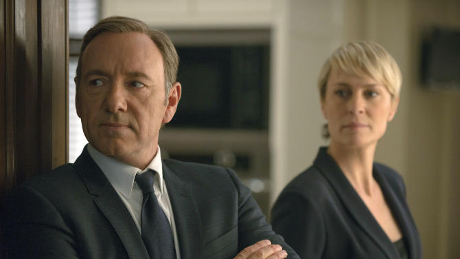 """FILE - This image released by Netflix shows Kevin Spacey as Francis Underwood, left, and Robin Wright as Clair Underwood in a scene from """"House of Cards."""" Netflix reports quarterly earnings on Monday, April 21, 2014. (AP Photo/Netflix, Nathaniel E. Bell, File)"""