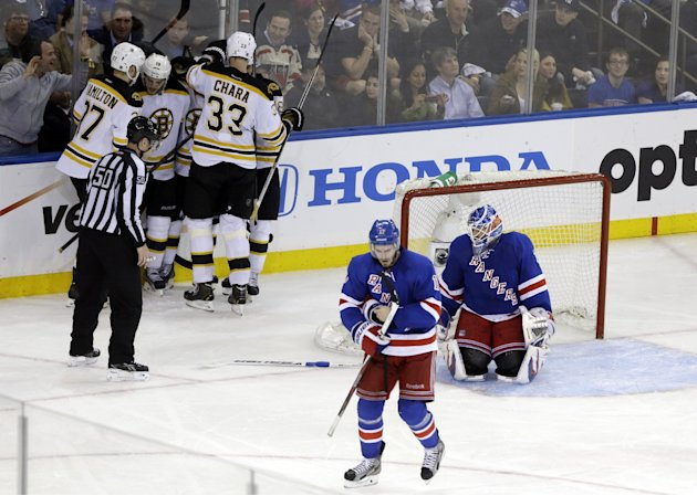 The Boston Bruins celebrate a goal by Tyler Seguin as New York Rangers goalie Henrik Lundqvist, right, and John Moore (17) react during the third period in Game 4 of the Eastern Conference semifinals