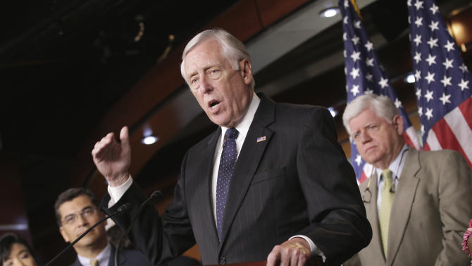 House Minority Whip Steny Hoyer of Md., center, flanked by Rep.  John Larson, D-Conn., right, and Rep. Xavier Becerra, D-Calif., gestures during a news conference on Capitol Hill in Washington, Monday, July 25, 2011.  (AP Photo/J. Scott Applewhite)