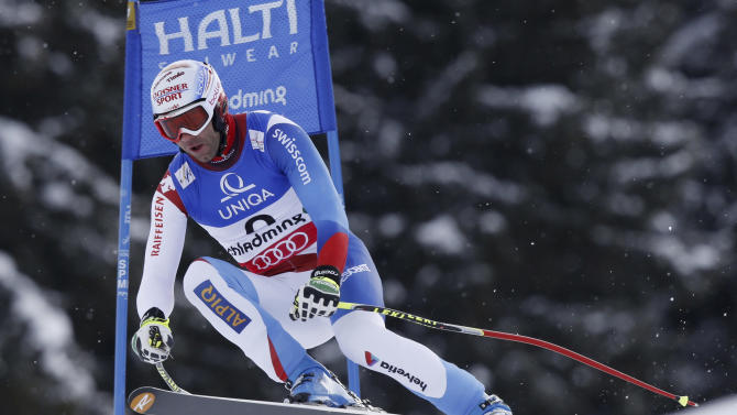 Switzerland's Didier Defago speeds down the course during training for the men's downhill, at the Alpine skiing world championships in Schladming, Austria, Thursday, Feb.7, 2013. (AP Photo/Alessandro Trovati)