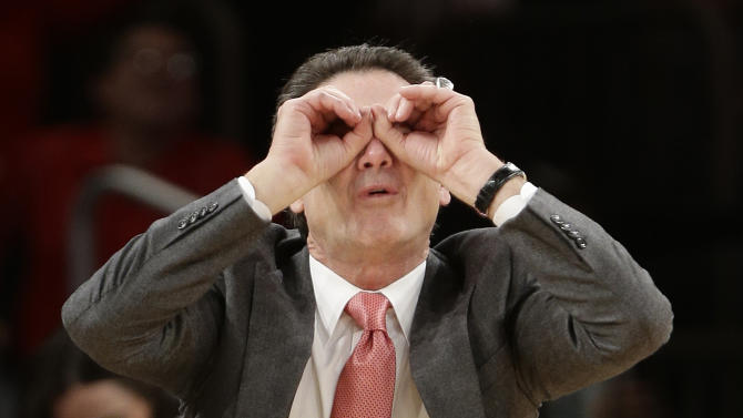 Louisville coach Rick Pitino gestures to his team during the second half of an NCAA college basketball game against Notre Dame at the Big East Conference tournament Friday, March 15, 2013, in New York. Louisville won 69-57. (AP Photo/Frank Franklin II)