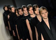 Models wear designs at the Victoria Beckham show during the Mercedes-Benz Fashion Week Fall 2013 collections on February 10, 2013 in New York. Victoria Beckham, who moved back to London a few months ago, on Sunday sent out a ready-to-wear collection for next winter infused with British flair -- tweed, plaid and her first attempt at knitwear