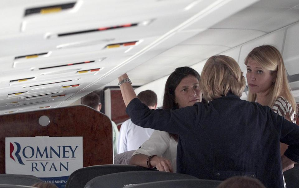 Janna Ryan, wife of Republican vice presidential candidate, Rep. Paul Ryan's, R-Wis., right, speaks to his mother Betty Ryan Douglas, center and sister in law Oakleigh Ryan on the campaign charter flight from Wisconsin to Tampa, Fla., Tuesday, Aug. 28, 2012.  (AP Photo/Mary Altaffer)