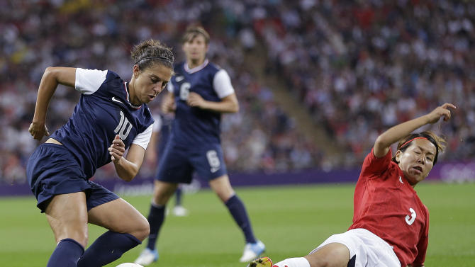 United States' Carli Lloyd (10) and Japan's Azusa Iwashimizu (3) fight for control of the ball during the women's soccer gold medal match at the 2012 Summer Olympics, Thursday, Aug. 9, 2012, in London. (AP Photo/Lefteris Pitarakis)