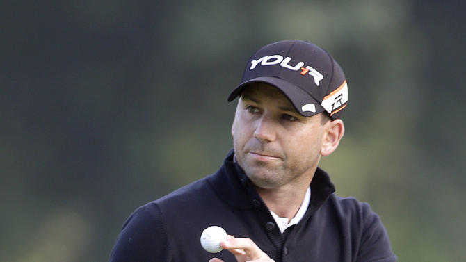 Sergio Garcia, of Spain, makes birdie on the seventh hole in the first round of the Northern Trust Open golf tournament at Riviera Country Club in the Pacific Palisades area of Los Angeles, Thursday, Feb. 14, 2013. (AP Photo/Reed Saxon)