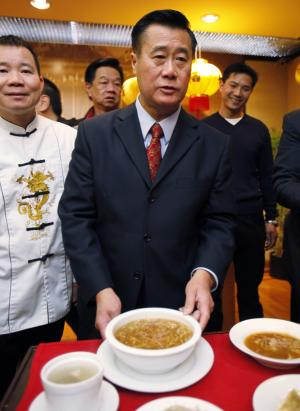 FILE - In this Feb. 14, 2011, file photo, State Sen. Leland Yee poses beside a bowl of shark fin soup during a news conference to oppose a bill to ban the sale of shark fin soup in San Francisco's Chinatown. Yee was arrested Wednesday March 26, 2014, during a series of raids in the San Francisco Bay Area. Yee declined to discuss the charges, citing an ongoing investigation. (AP Photo/Paul Sakuma, File)