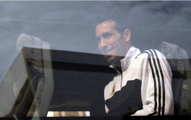 Mohamed Aboutrika of Egypt's Al Ahly smiles from the bus to fans after Friday prayers at Lebanon Mosque in Agadir