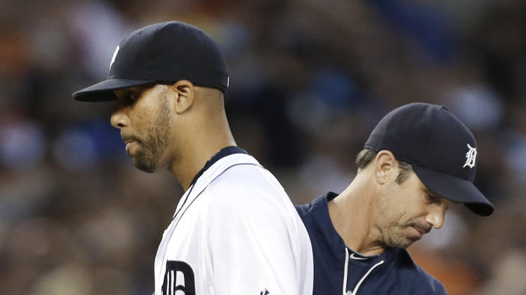 Detroit Tigers pitcher David Price, left, is taken out of a baseball game by manager Brad Ausmus in the third inning of a baseball game against the New York Yankees in Detroit, Wednesday, Aug. 27, 2014. Price allowed eight earned runs. (AP Photo/Paul Sancya)
