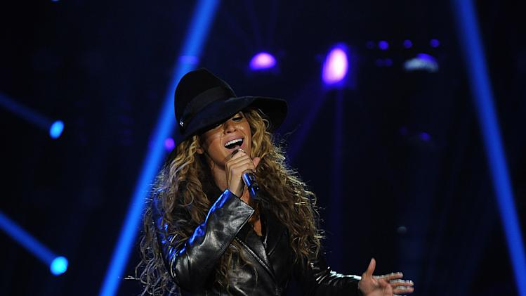 "Singer Beyonce performs on her ""Mrs. Carter Show World Tour 2013"", on Monday, April 22, 2013 at the Ziggo Dome in Amsterdam, Netherlands. Beyonce is wearing a leather coat and boots by Pucci. (Photo by Frank Micelotta/Invision for Parkwood Entertainment/AP Images."