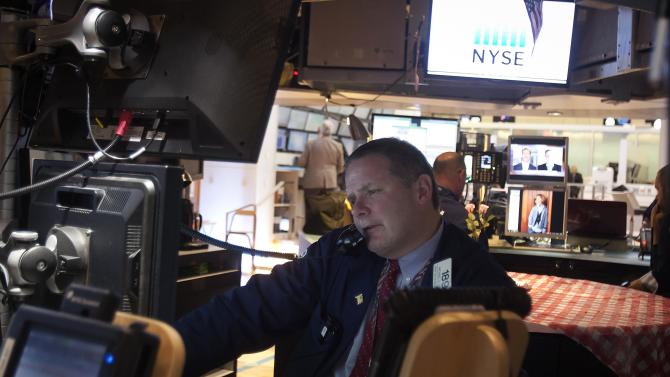 A trader works on the floor of the New York Stock Exchange as it was open during Winter Storm Juno in the Manhattan borough of New York