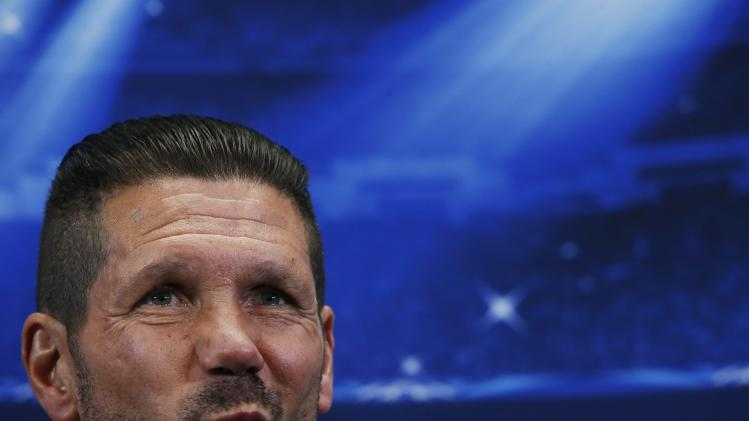 Atletico Madrid's coach Simeone attends a news conference at Vicente Calderon stadium in Madrid