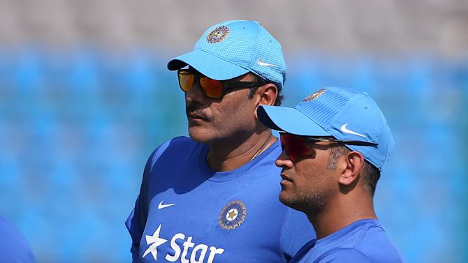 India's captain Dhoni talks to his Team Director Shastri during a practice session ahead of their first one-day international cricket match against South Africa in Kanpur