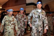 Members of UN monitors team, tasked with monitoring the UN-backed ceasefire in Syria, arrive in Sheraton hotel in Damascus on April 23 after visiting several rebellious suburbs near the capital. Nearly 60 people were reported killed in violence across Syria on Monday despite a hard-won ceasefire and the upcoming deployment of 300 UN observers to monitor the truce, a watchdog said