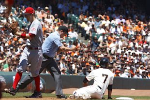 Gregor Blanco (right) and the Giants were swept by the Reds at home. (Getty Images)