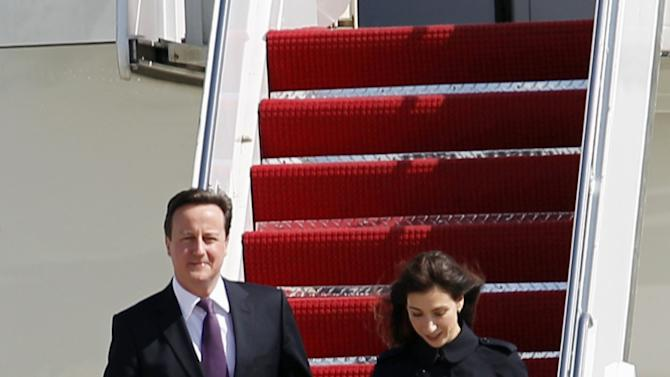 British Prime Minister David Cameron and his wife Samantha walk down the stairs from the plane upon arrival their at Andrews Air Force Base, Md., Tuesday, March 13,  2012. (AP Photo/Jose Luis Magana)
