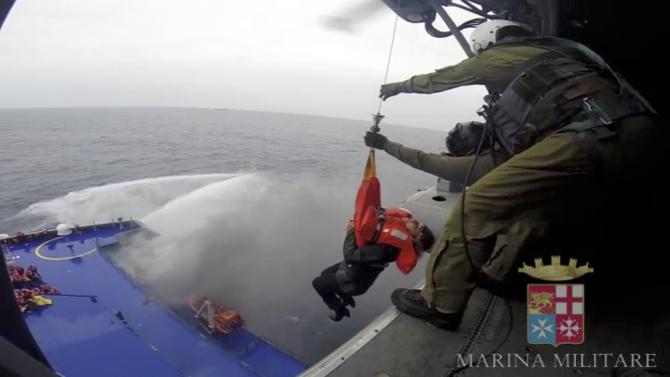Handout video grab showing a person being lifted on an Italian Navy helicopter as the car ferry Norman Atlantic burns in waters off Greece
