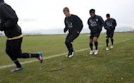 Maxim Molokoedov (2nd L) takes part in a training session with Chilean second division football team, Santiago Morning. The Russian, who under provisions in Chilean law could complete his sentence in his own country, has chosen to remain in Chile instead, in order to keep playing for Santiago Morning