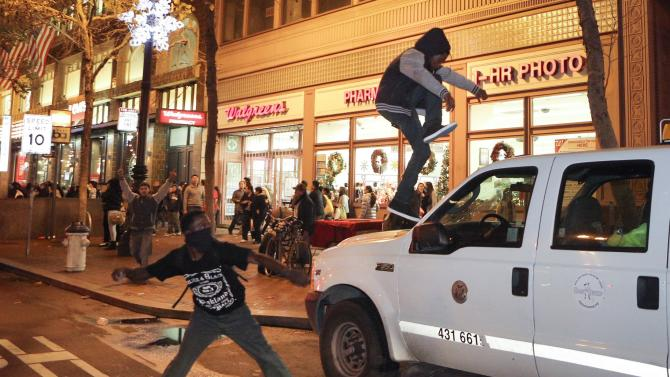 Protesters try to smash the windshield of a truck during a demonstration against the grand jury decision in the Ferguson, Missouri shooting of Michael Brown in San Francisco, California