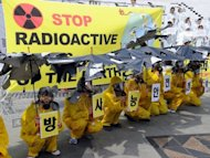 "South Korean activists at an anti-nuclear protest in Seoul last year. South Korea was forced to shut down two nuclear reactors on Monday to replace components that had not been properly vetted, a minister said, warning of ""unprecedented"" power shortages to follow"