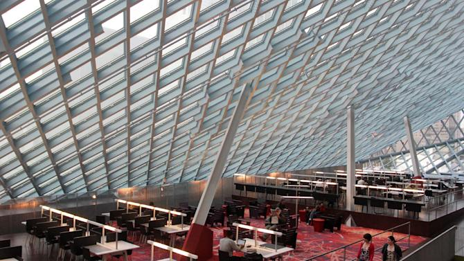 This image taken April 3, 2013 shows the interior of the Seattle Central Library in downtown Seattle. The $165 million building's unusual design and decoration attracts visitors from all over the world. (AP Photo/Manuel Valdes)