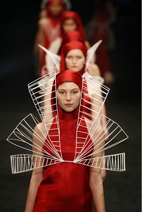 CORRECTS DESIGNER'S NAME - Models shows off creations by Portuguese designer Olga Noronha during the ModaLisboa fashion week, in Lisbon, Portugal Friday, March 7, 2014. (AP Photo/Francisco Seco)