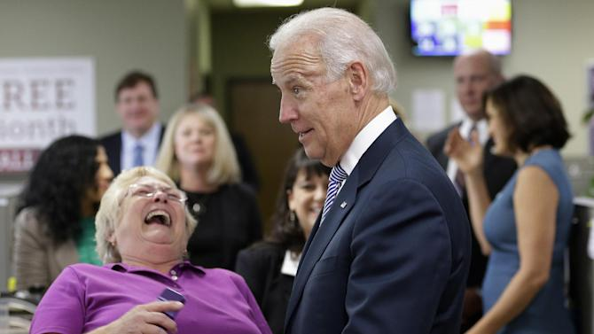 Vice President Joe Biden jokes with advocates as he visits the headquarters of the National Domestic Violence Hotline in West Lake Hills, Texas, Wednesday, Oct. 30, 2013, to help commemorate National Domestic Violence Awareness Months. (AP Photo/Eric Gay)