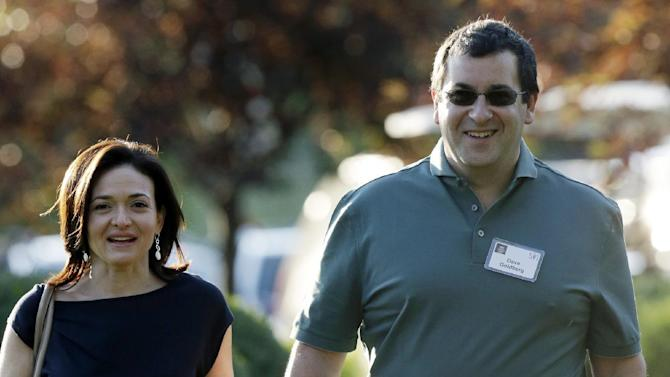 FILE - In this July 10, 2013 file photo, Sheryl Sandberg, COO of Facebook, left, and her husband David Goldberg, CEO of SurveyMonkey, walk to the morning session at the Allen & Company Sun Valley Conference in Sun Valley, Idaho. Goldberg was exercising at a gym in a Mexican resort when he collapsed before he died Friday, May 1, 2015, a person close to the family says. (AP Photo/Rick Bowmer, File)
