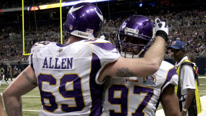 Minnesota Vikings defensive end Everson Griffen, right, is congratulated by teammate Jared Allen after intercepting a pass and running it back 29 yards for a touchdown during the second quarter of an NFL football game against the St. Louis Rams Sunday, Dec. 16, 2012, in St. Louis. (AP Photo/Tom Gannam)