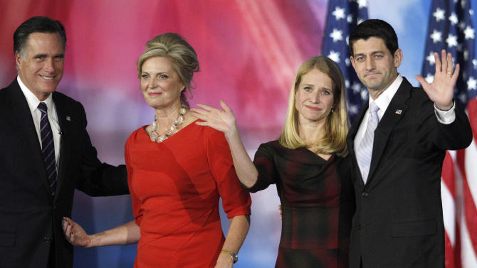 Republican presidential candidate and former Massachusetts Gov. Mitt Romney and his wife Ann Romney, left, and vice presidential candidate, Rep. Paul Ryan, R-Wis., and his wife Janna, right, wave to supporters after Romney conceded the race during his election night rally, Wednesday, Nov. 7, 2012, in Boston. (AP Photo/Stephan Savoia)