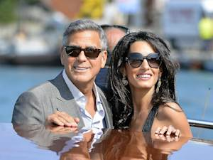 US actor George Clooney ( L) and Amal Alamuddin take …