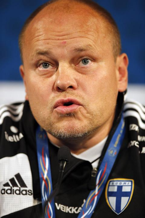 Finland's head coach Mixu Paatelainen attends a press conference at the Stade de France stadium in Saint Denis, north of Paris, Monday, Oct. 14, 2013, ahead of their 2014 World Cup Group I qualifying