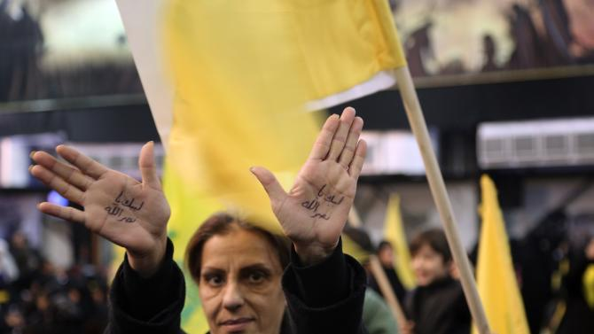 Woman holds up her hands as Lebanon's Hezbollah leader Nasrallah speaks at event to commemorate deaths of six Hezbollah fighters and Iranian general killed by Israeli air strike in Syria, in Beirut