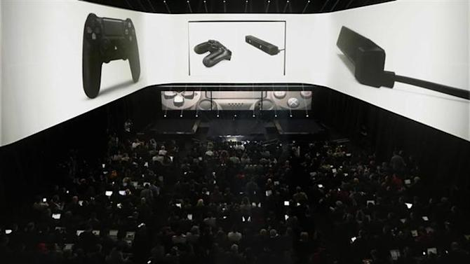 People attend the PlayStation 4 launch event in New York, February 20, 2013. REUTERS/Brendan McDermid/Files
