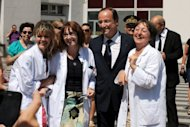 &lt;p&gt;French President Francois Hollande (C) speaks with nurses on August 11 after a visit to the hospital in Grenoble where an injured jeweler was hospitalized after a holdup. Hollande will celebrate 100 days since his election as French president on Tuesday knowing his honeymoon with the electorate is over and that life is not going to get easier any time soon.&lt;/p&gt;