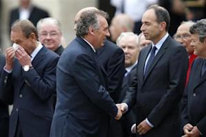 French UMP political party head Jean-Francois Cope, Francois Bayrou, France's centrist MoDem party leader, and Jean-Louis Borloo, head of the Union Democratic Independant, attend a ceremony in the courtyard of the Invalides in Paris