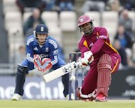 Dwayne Smith of the West Indies (R) hits a shot watched by England's wicketkeeper Craig Kieswetter. England beat the West Indies by 114 runs under the Duckworth/Lewis method