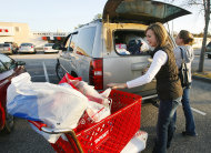 <p>               FILE - In this Nov. 25, 2011 file photo, Rhonda Cochran, left, and Tiffany Strickland load bags of Black Friday deals into a car at Bel Air Mall in Mobile, Ala. Retailers are reporting strong sales gains in November, boosted by a discount-fueled spending binge for the start of the holiday shopping season last weekend. Now, the challenge is to keep shoppers spending throughout the most important selling period of the year. (AP Photo/Mobile Press-Register, Mike Kittrell) MAGS OUT; NO SALES